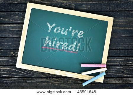 You're hired text on school board and chalk