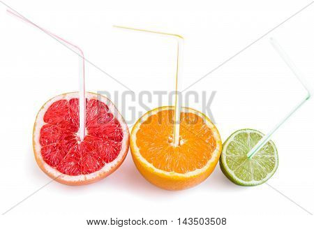 Halves of grapefruit orange and lime with straws as cocktails isolated over white. Healthy nutrition concept.