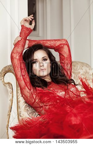 Glamorous Woman with dark hair Lying on a Sofa
