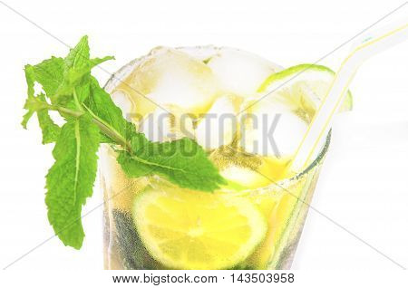Misted glass of mojito cocktail isolated over white. Close-up. Horizontal.