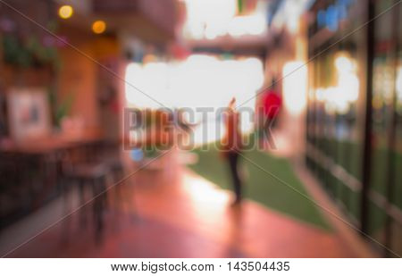 Blurred Image Of Shopping Mall And People.