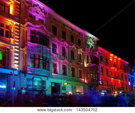 Festival climate Lodz. Lodz, Poland October 12, 2012 Historic houses on Piotrkowska Street in Lodz, lights illuminated during the Festival of the kinetic art of light in 2012.