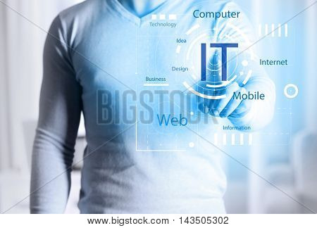 Male hand pushing button on virtual screen. IT technologies concept.