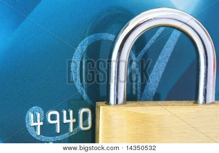 Business security: brass padlock on credit card.  Macro view.
