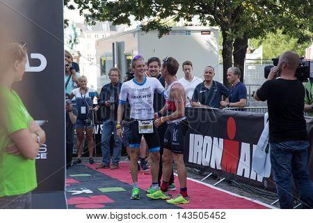 Copenhagen, Denmark - August 21, 2016: Winner Patrik Nilsson congratulating the 2nd Will Clarke in men's at the KMD Ironman Copenhagen 2016