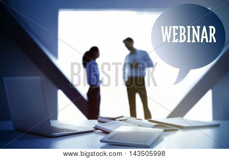 Business training concept. Workplace with laptop and documents on conference background