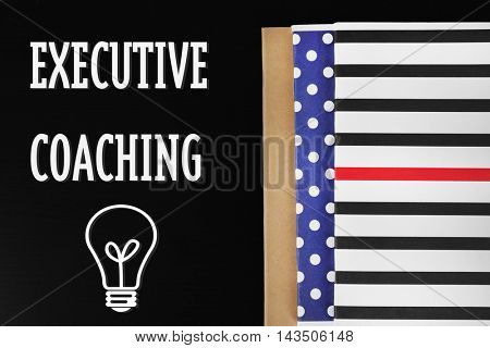 Notebooks on black table. Executive coaching concept