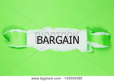 BARGAIN word written under green torn paper