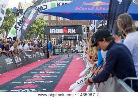 Copenhagen, Denmark - August 21, 2016: Triathlete Fabio Carvalho just before crossing the finish line as 3rd in men's in 08:07:10 at the KMD Ironman Copenhagen 2016