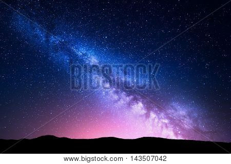 Milky Way And Pink Light At Mountains. Night Colorful Landscape.