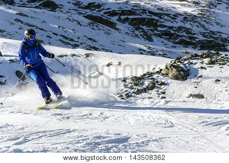 SWITZERLAND, SAAS-FEE, DECEMBER, 26, 2015 - Skier on snowy slope Felskinn snow sports routes with natural snow. Varied routes for freeriders and snowboarders at an altitude of 2550 m near Saas-Fee, Switzerland.