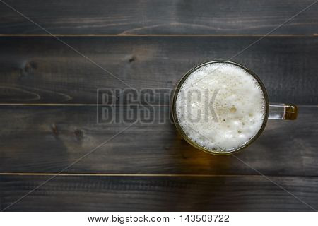glass beer on wooden background with copy space top view
