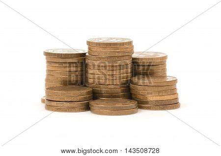 Stacks of golden coins isolated on a white background. Money and wealth. Prosperity and success. Economy and finance.