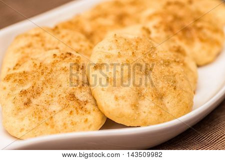 Vegan Butter and Cinnamon cookies on a white plate