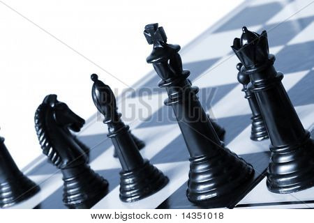 Chessboard,with focus on black king and queen.