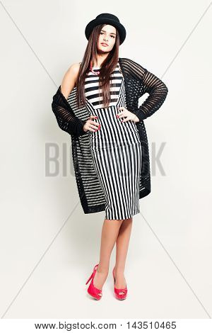 Glamorous Woman in Striped Dress. Fashion Portrait