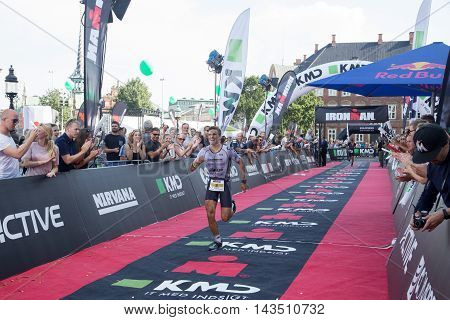 Copenhagen, Denmark - August 21, 2016: The 4th Alberto Casadei and the 5th Igor Amorelli in men's just before crossing the finish line at the KMD Ironman Copenhagen 2016