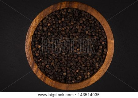 Black Pepper In Wooden Bowl