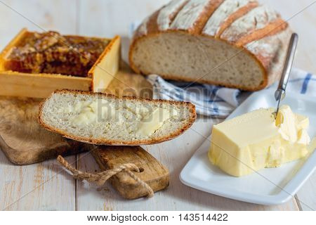 Piece Of Bread With Butter Close Up.