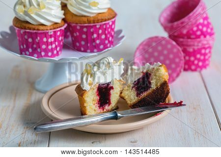 Lemon Cupcakes With Fruit Filling.