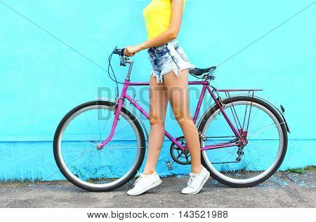 Fashion Pretty Woman And Bicycle Over Colorful Blue Background In Profile
