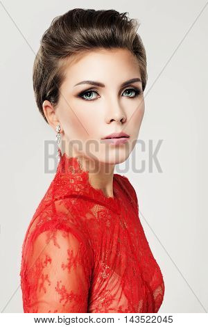 Glamorous Beauty. Woman with Makeup and Hairstyle