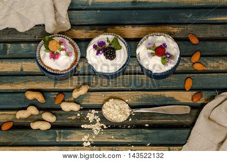 Beautiful Muffins With Berries On Wooden Background Nuts Honey