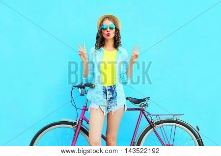 Fashion Pretty Woman With Bicycle Over Colorful Blue Background