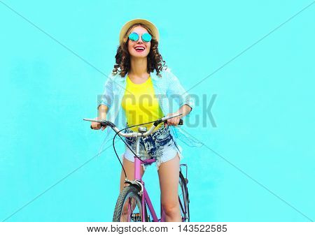 Happy Pretty Smiling Woman Rides A Bicycle Over Colorful Blue Background