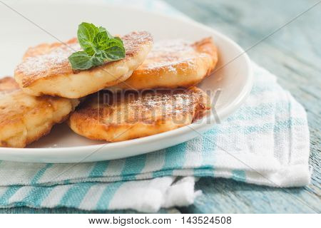 Cottage Cheese Pancakes On A White Plate