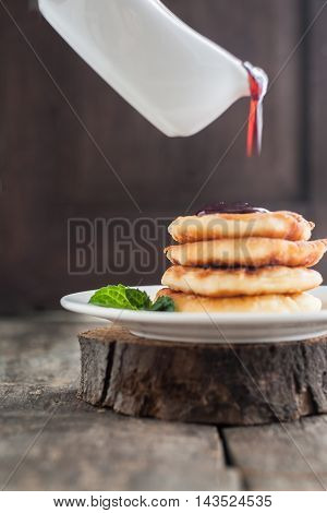 Pour On The Cottage Cheese Pancakes Jam On A Dark Wooden Background