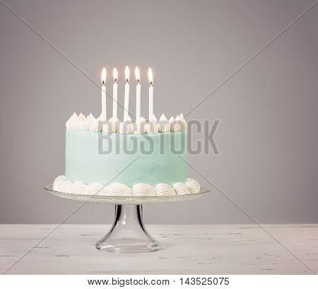 Blue Birthday Cake Over Grey Background.