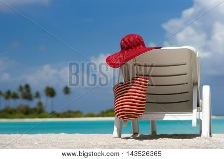 Beach Chairs With Hat On White Sandy Beach