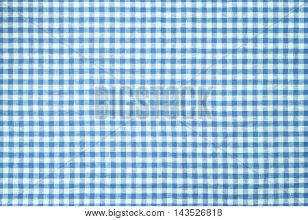 Blue checkered tablecloth vor texture or background