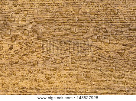 Oak background with raindrops - Great wooden background with a section from an oak plank with water drops on it. The wood, which is treated with a special oil, is waterproof.