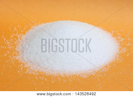 Sugar in a bowl isolated on white background, top view