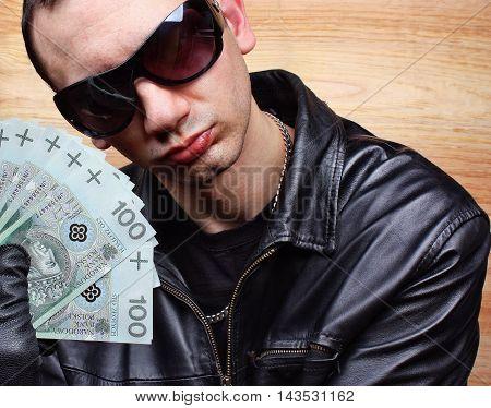 Mafia gangster with a fan polish money
