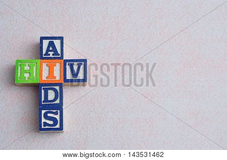 The words aids and hiv spelled with colorful blocks isolated on a white background