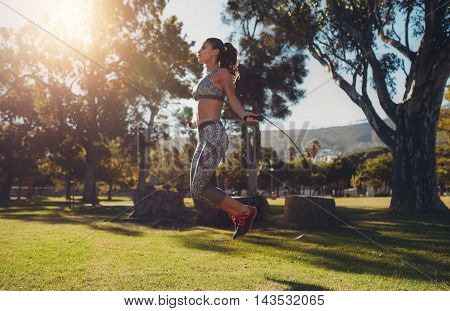 Fit Young Woman Skipping With A Jump Rope In The Park