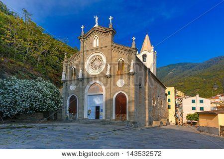Church of San Giovanni Battista in Riomaggiore fishing village in Five lands, Cinque Terre National Park, Liguria, Italy.