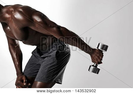 African Man Doing Dumbbell Exercise For Arms