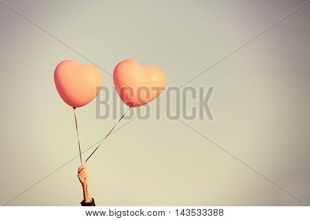 Love heart balloons on sky background