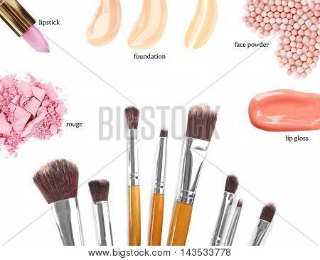 Makeup brushes and cosmetics, isolated on white