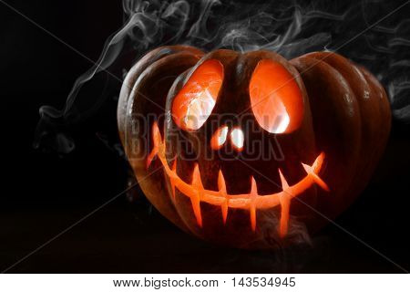Halloween pumpkin on table on dark background