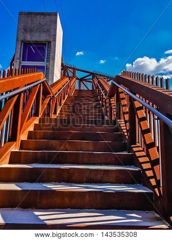 rust stairs going up to the blue sky
