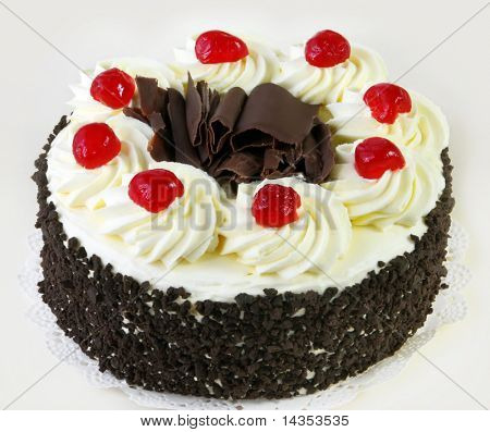Black forest cake, topped with whipped cream and cherries.