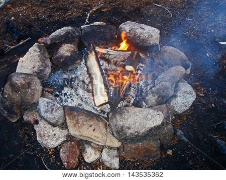 smoldering fire wine and food from camping