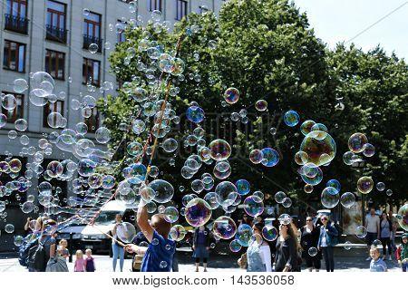 PRAGUE, CZECH REPUBLIC - JUNE 17, 2016: Holiday soap bubbles in the street in Prague