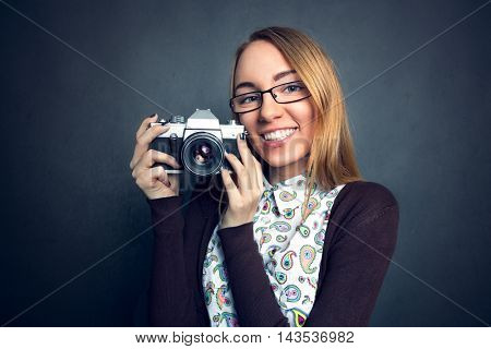Cute girl with her camera, concept I love photography