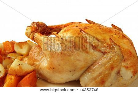 Roast chicken with baked vegetables, ready for serving.